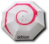 Un parapluie blanc avec une spirale Debian rouge dessus