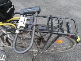 Homemade U-lock holder on a bicycle rack